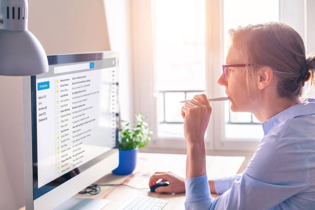 Female business person reading email