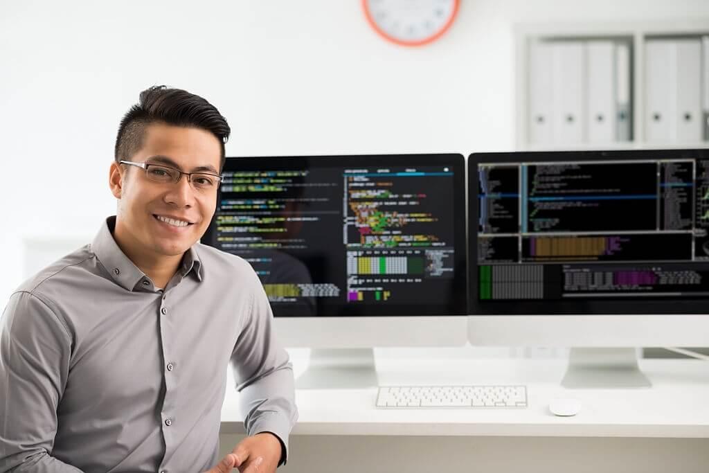 Portrait of smiling software engineer